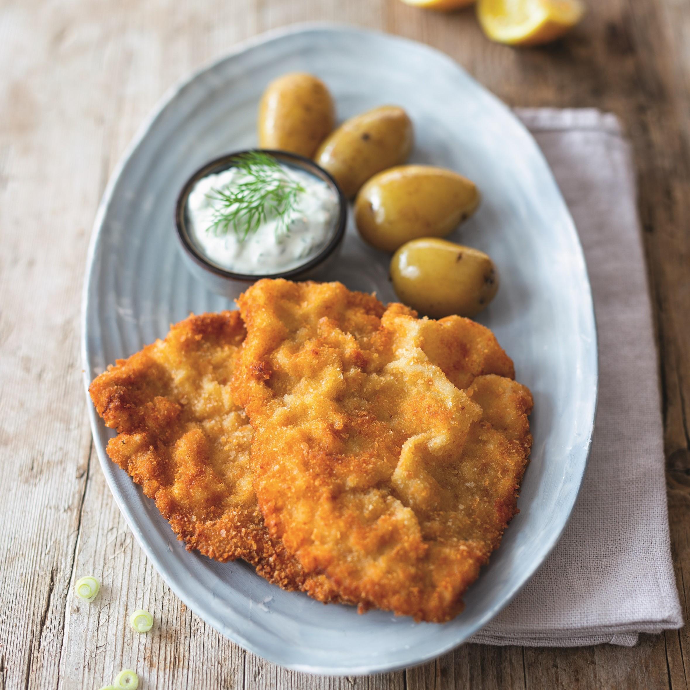 Schnitzel mit jungen Kartoffeln und Kräutersauce - Rezept Bild